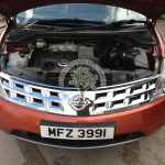 Nissan Murano 3.5 engine bay view with LPG system in place all covered out of view